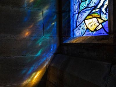 Light through the south chancel window with signature
